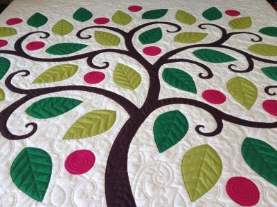 Original source: http://blog.ninapaley.com/wp-content/uploads/2014/04/TreeAppliqueDone1.jpg