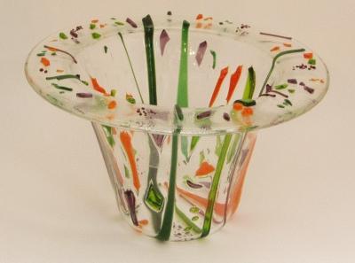 Original source: https://glassart.files.wordpress.com/2007/05/candle-vase-clear-tack-fused-colors.jpg