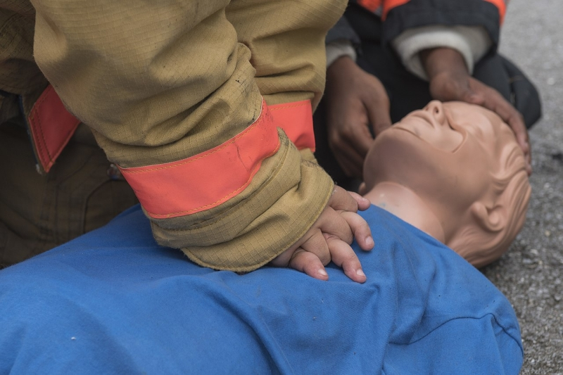 Original source: https://upload.wikimedia.org/wikipedia/commons/thumb/d/d3/Joint_Base_Andrews_Fire_Explorer_Academy_cadets_perform_CPR_on_a_training_dummy.jpg/1280px-Joint_Base_Andrews_Fire_Explorer_Academy_cadets_perform_CPR_on_a_training_dummy.jpg
