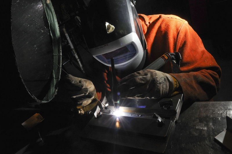Original source: https://upload.wikimedia.org/wikipedia/commons/thumb/2/27/US_Navy_090715-N-5821P-002_Aviation_Support_Equipment_Technician_Airman_Anthony_Hammond_performs_tungsten_inert_gas_welding_during_a_training_evolution.jpg/1280px-US_Navy_090715-N-5821P-002_Aviatio