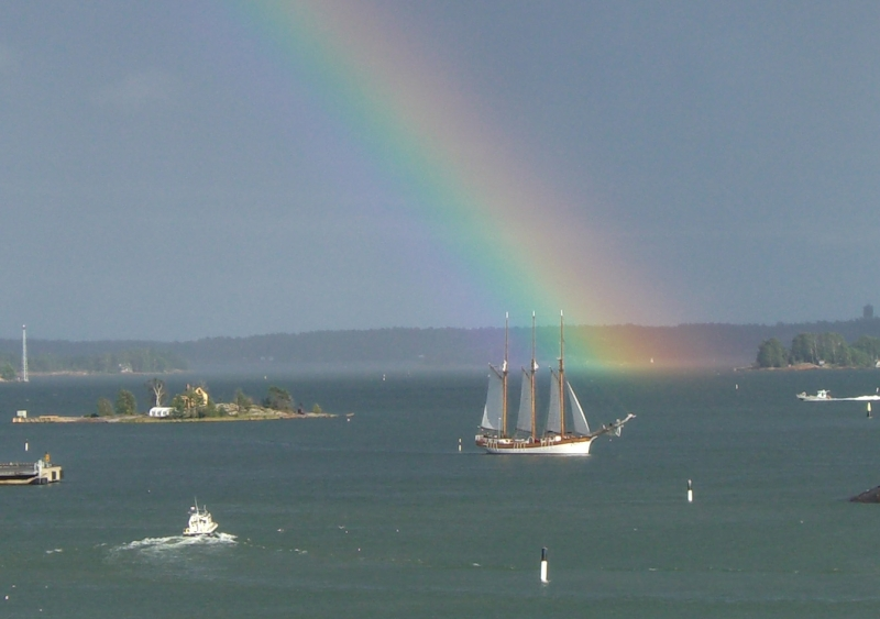 Original source: https://upload.wikimedia.org/wikipedia/commons/f/f3/Sailing_boat_under_rainbow_in_Helsinki.jpg