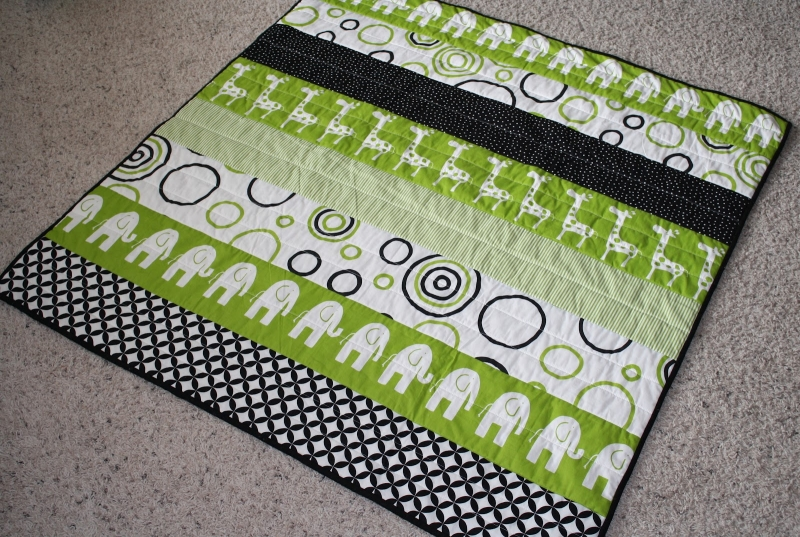 Original source: http://2.bp.blogspot.com/-cCvWb1HbPwk/T5F_tc79_3I/AAAAAAAAAC0/-Xb9pJBZWNM/s1600/04-12-12_Modern_Strip_Quilt_4.JPG