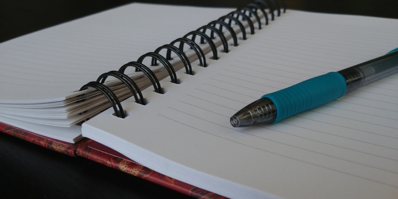 Original source: https://storage.needpix.com/rsynced_images/open-notebook-with-blue-pen.jpg