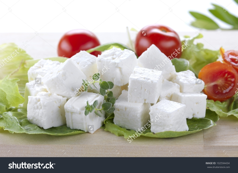Original source: http://image.shutterstock.com/z/stock-photo-feta-cheese-cut-in-cubes-vegetables-herbs-and-olive-oil-the-ingredients-for-a-greek-salad-102594434.jpg