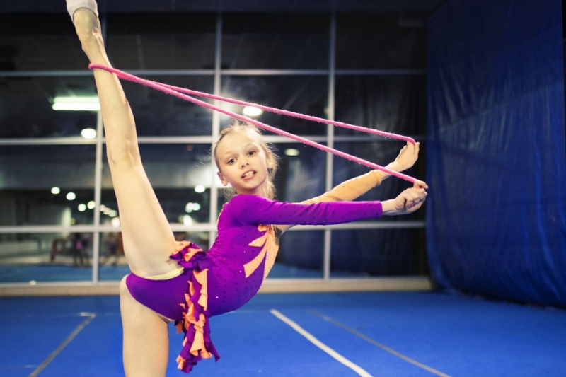 Original source: https://pixfeeds.com/images/sports/gymnastics/1280-660184562-girl-performing-rhythmic-gymnastics.jpg