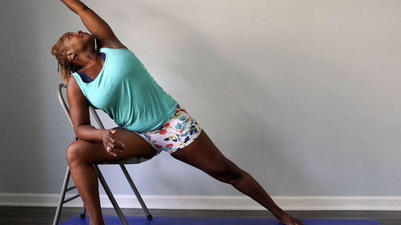 Original source: https://cdn.omstars.com/__sized__/redefining_chair_yoga_release_6.28.21_1-thumbnail-1400x1400-70.jpg