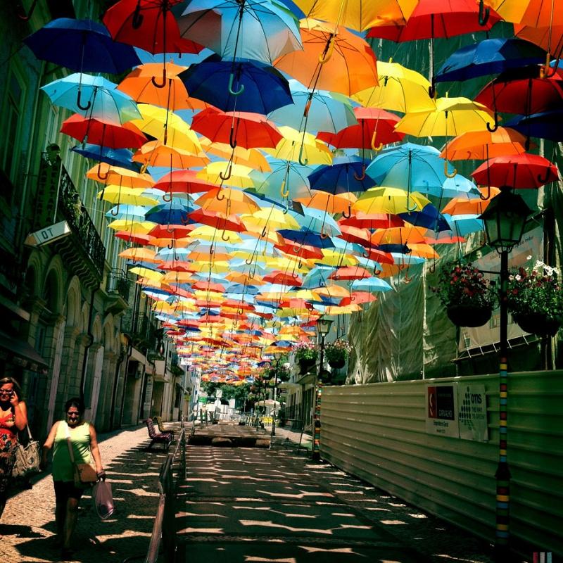 Original source: http://demilked2.uuuploads.com/floating-umbrellas-agueda-portugal-2013/floating-umbrellas-agueda-portugal-2013-2.jpg