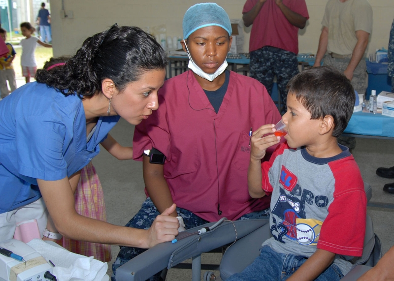 Original source: https://upload.wikimedia.org/wikipedia/commons/thumb/e/ee/US_Navy_100911-N-3265K-052_Hospital_Corpsman_2nd_Class_Breneah_B._Bromfield_watches_a_Guatemalan_child_rinse_his_mouth.jpg/1280px-US_Navy_100911-N-3265K-052_Hospital_Corpsman_2nd_Class_Breneah_B._B