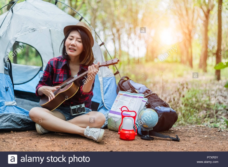 Original source: https://c8.alamy.com/comp/P7XR5Y/beautiful-asian-woman-playing-ukulele-in-front-of-camping-tent-in-pine-woods-people-and-lifestyles-concept-adventure-and-travel-theme-P7XR5Y.jpg
