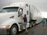 Original source: https://upload.wikimedia.org/wikipedia/commons/thumb/4/49/FEMA_-_39317_-_FEMA%5E%5E39,s_Richard_Hainje_talks_to_a_truck_driver_in_Kansas.jpg/1280px-FEMA_-_39317_-_FEMA%5E%5E39,s_Richard_Hainje_talks_to_a_truck_driver_in_Kansas.jpg