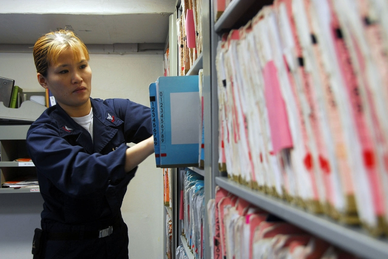 Original source: https://upload.wikimedia.org/wikipedia/commons/thumb/2/2d/US_Navy_090123-N-9760Z-004_Hospital_Corpsman_2nd_Class_Jennifer_Ross_files_medical_records_aboard_the_aircraft_carrier_USS_Nimitz_%28CVN_68%29.jpg/1280px-US_Navy_090123-N-9760Z-004_Hospital_Corpsma