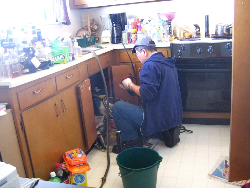 Original source: https://upload.wikimedia.org/wikipedia/commons/thumb/f/fa/Plumber_at_work.jpg/1280px-Plumber_at_work.jpg