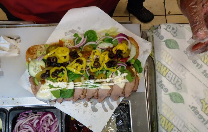 Original source: https://upload.wikimedia.org/wikipedia/commons/1/1e/Food_service_worker_preparing_a_submarine_sandwich_at_Subway.JPG