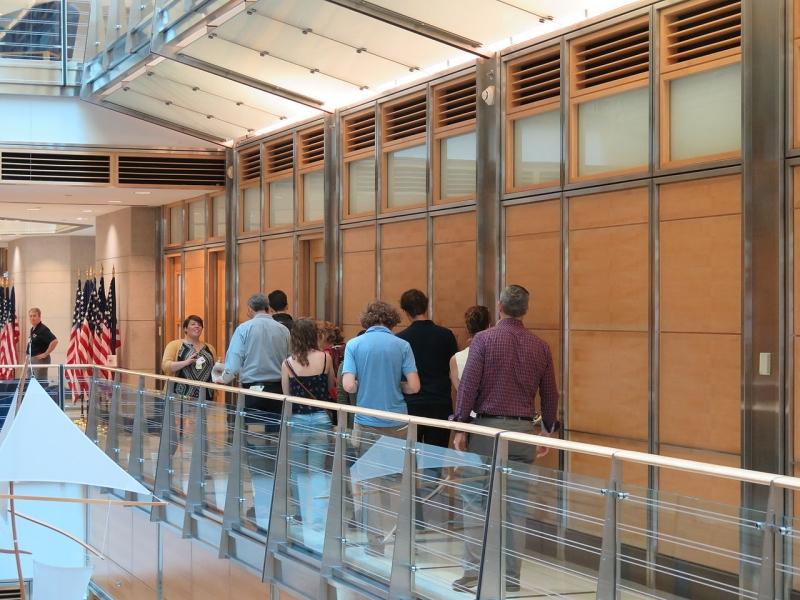 Original source: https://upload.wikimedia.org/wikipedia/commons/thumb/9/96/Visitors_walk_down_a_hallway_in_the_US_Embassy_during_Doors_Open_Ottawa_2015_%2818615108091%29.jpg/1280px-Visitors_walk_down_a_hallway_in_the_US_Embassy_during_Doors_Open_Ottawa_2015_%2818615108091