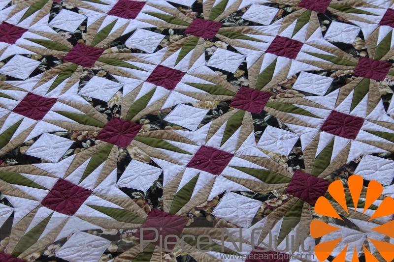 Original source: http://2.bp.blogspot.com/-IRHUbocAXy0/VFl27N2tOpI/AAAAAAAAeKc/9UjQS3DlfbE/s1600/paper%2Bpieced%2Bquilt%2Bmachine%2Bquilting%2Bby%2Bnatalia%2Bbonner%2Bof%2Bpiece%2Bn%2Bquilt.jpg